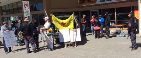People beginning to gather in front of downtown Sudbury's Rainbow Centre for the rally against Bill C-51. (Photo by Scott Neigh)