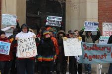 Demonstrators at the Solidarity Against Austerity action in Sudbury delivering an anti-austerity message in front of Liberal MPP Rick Bartolucci's office. (Photo by Larson Heinonen)