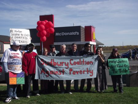 Demonstrators outside McDonald's on Notre Dame Avenue in Sudbury, Ontario, calling for an increase in the minimum wage to $14 an hour.