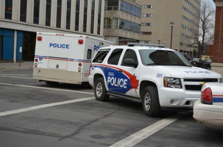 Sudbury police vehicles at an action where eleven anti-poverty activists in Sudbury were arrested in 2012. (Photo from Sudbury Coalition Against Poverty)