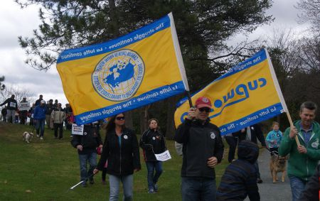"Beautiful yellow and blue flags were carried during the ""walking for our postal carriers"" event."