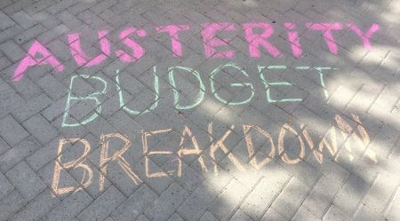 Some of the sidewalk chalking at the Austerity Budget Breakdown Funfest in front of the Provincial Building in downtown Sudbury.