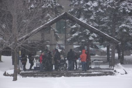 People beginning to gather in Memorial Park in downtown Sudbury for the Solidarity Agaisnt Austerity rally, meal, and march, despite the weather. (Photo by Scott Neigh)