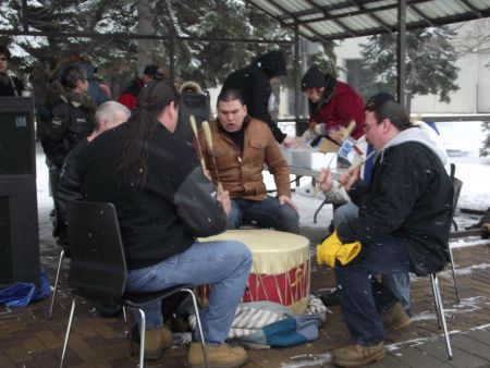 The N'Swakamok Native Friendship Centre drumming group doing an opening song at the Solidarity Against Austerity action in Memorial Park. (Photo by Scott Neigh)