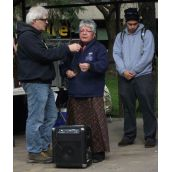 This photo shows S-CAP organizer Gary Kinsman holding the mic as Anishnabe elder Julia Ozawagosh gives an opening at the Friday afternoon event. Local Idle No More organizer Bruce McComber listens close behind. (Photo by Scott Neigh)