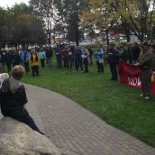Close to 100 people gathered on Friday afternoon in Memorial Park in downtown Sudbury to demand improvements to social assistance and to voice opposition to cuts to a benefit that helps keep people out of homelessness. (Photo by Scott Neigh)