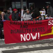 Along with the specific focus on disability benefits, the rally and march continued to present the demand that social assistance rates be restored to the same purchasing power they had in 1995, which would take a 55% increase. (Photo by Scott Neigh)