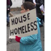 A young demonstrator demanding housing for the homeless. (Photo by Scott Neigh)
