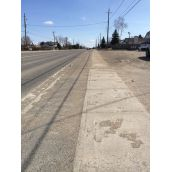 """Falconbridge Road.  """"There's a 6ft boulevard on each side of Falconbridge Hwy leading to Garson. Light posts are on resident's properties so the boulevard is free of obstructions. So easy to paint bicycles and make it a cycling route.""""  Photo by Lynn Despatie."""