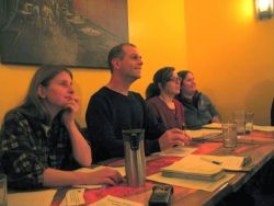 "This photo shows the panel at the Dec. 3 ""Challenge the City!"" forum at the Laughing Buddha in Sudbury, Ontario. From left to right are Naomi Grant (Coalition for a Liveable Sudbury), Jamie West (Sudbury and District Labour Council), and Anna Harbulik and Christy Knockleby (Sudbury Coalition Against Poverty). (Photo by Lilly Noble)"