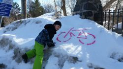 Some Family Day fun discovering bike stencils on snow bank.  Photo Credit:  Ernst Gerhardt