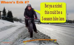 :  'Under each snow bank might be a bike lane in waiting.  Identify where Erik is riding on a potential boulevard bike lane, for a chance to win a mystery prize.' Photo Credit:  Naomi Grant and Cindy O'Neil