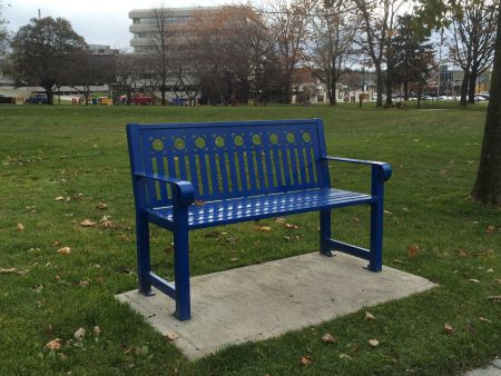 The newer style of bench in Memorial Park in downtown Sudbury, identified by Aho in her research as often used to prevent people from lying down. (Photo by Scott Neigh)